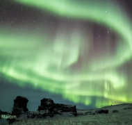 Amazing Aurora lightshow on lake Mývatn